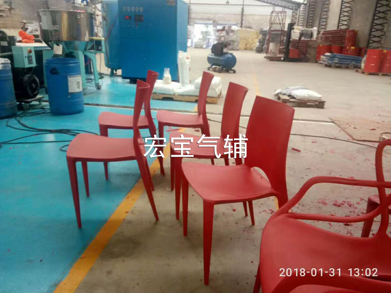 Gas-assisted plastic chair